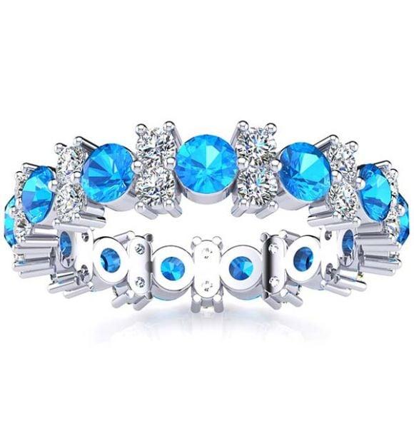 Garland Topaz And Diamond Ring